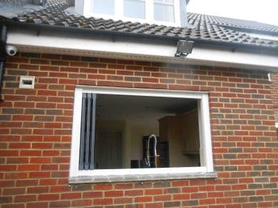 Frameless bifolding windows in new build home.