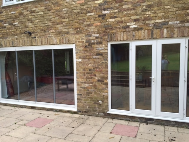 image of frameless and pvcu bifolding doors next to each other