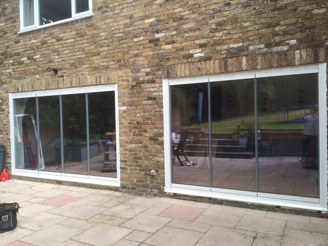 pic of two sets of frameless bifolding doors