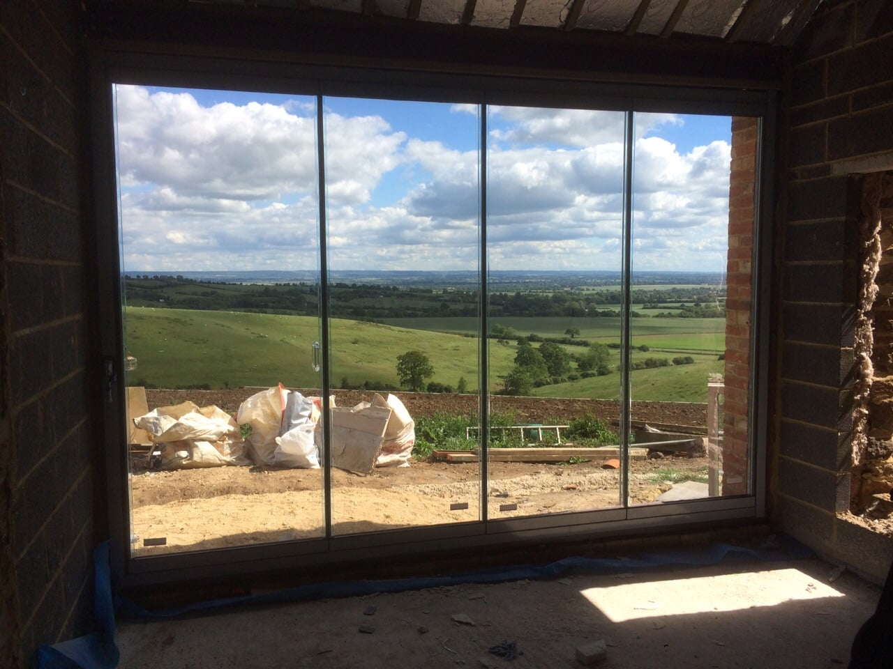 Frameless Glass Doors help keep the weather out