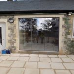 Cardiff frameless doors in stone surround image 1