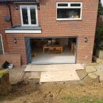 Grey frameless doors to new extension