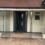 Frameless double door entrance porch