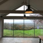 Beaminster Frameless doors & gable window image 1