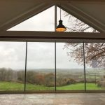 Beaminster Frameless doors & gable window image 2