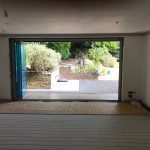 Nottinghamshire Frameless slide and fold doors.