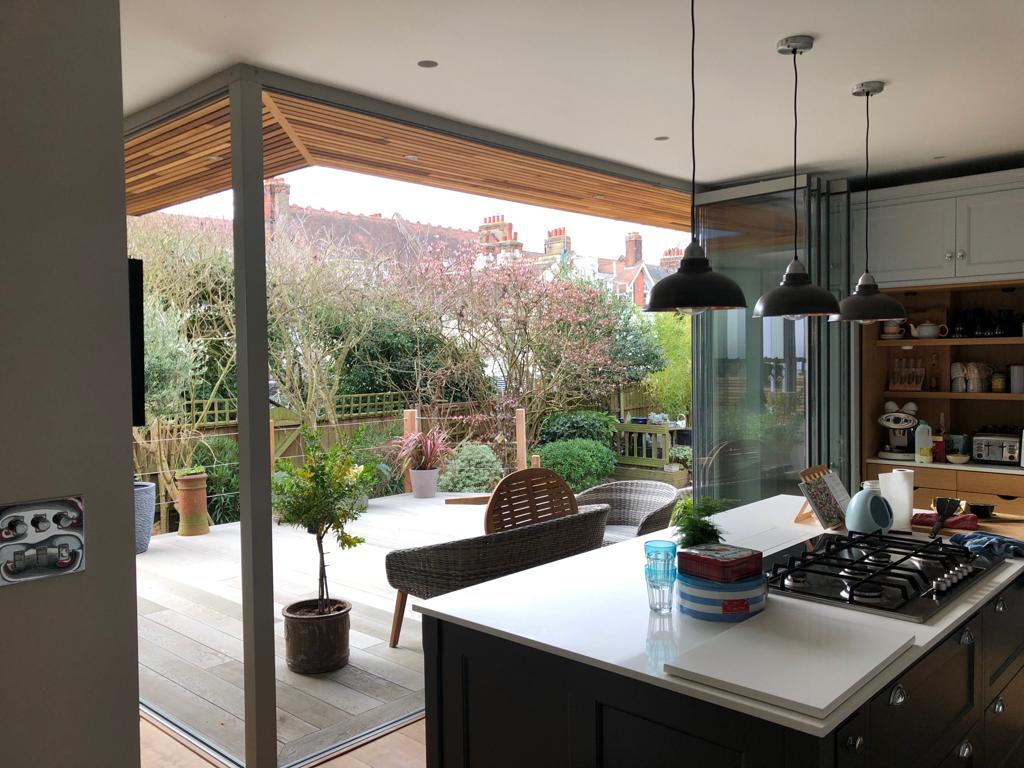 slide and turn doors in a new kitchen extension