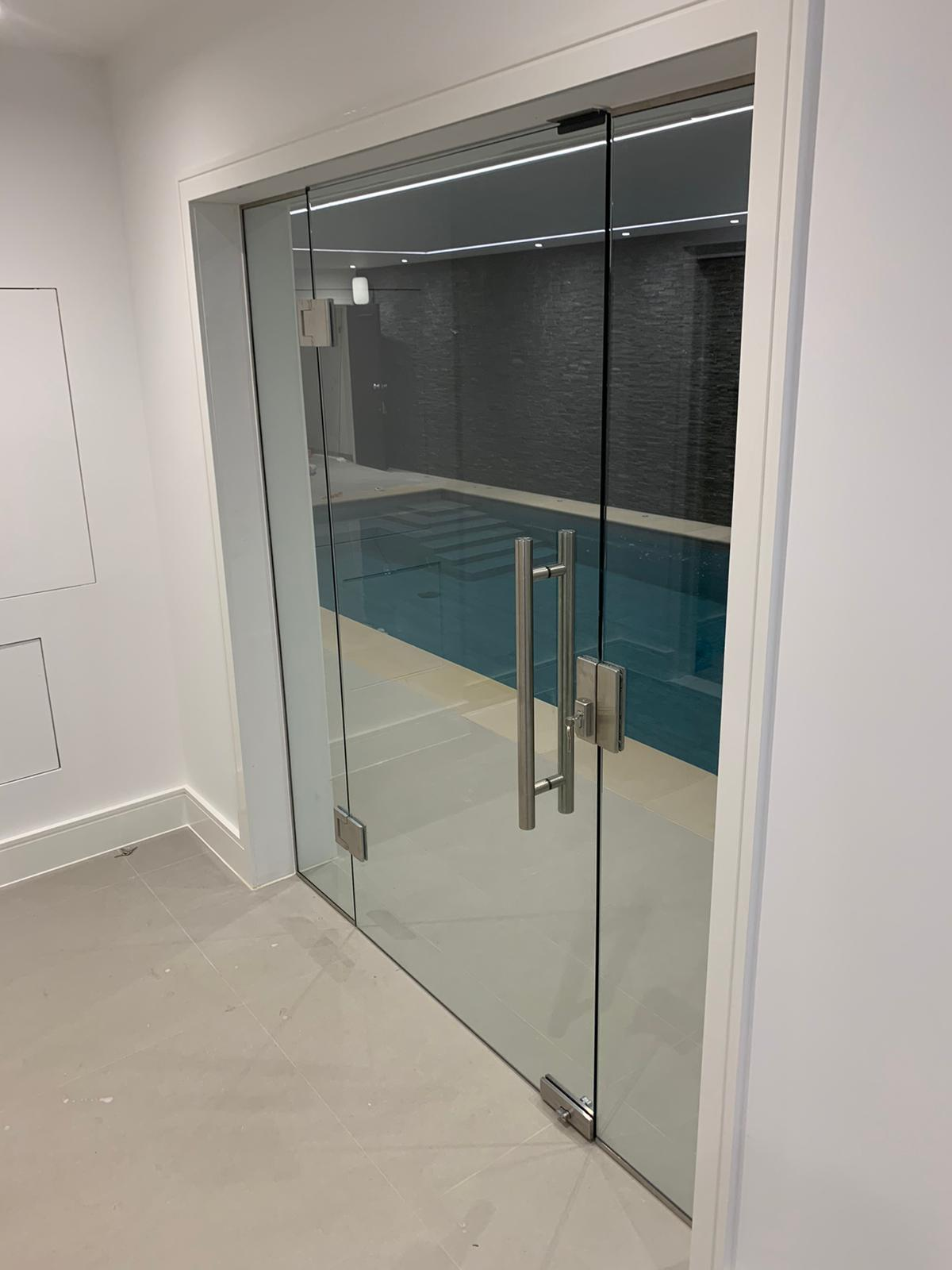 Swimming pool internal glass doors