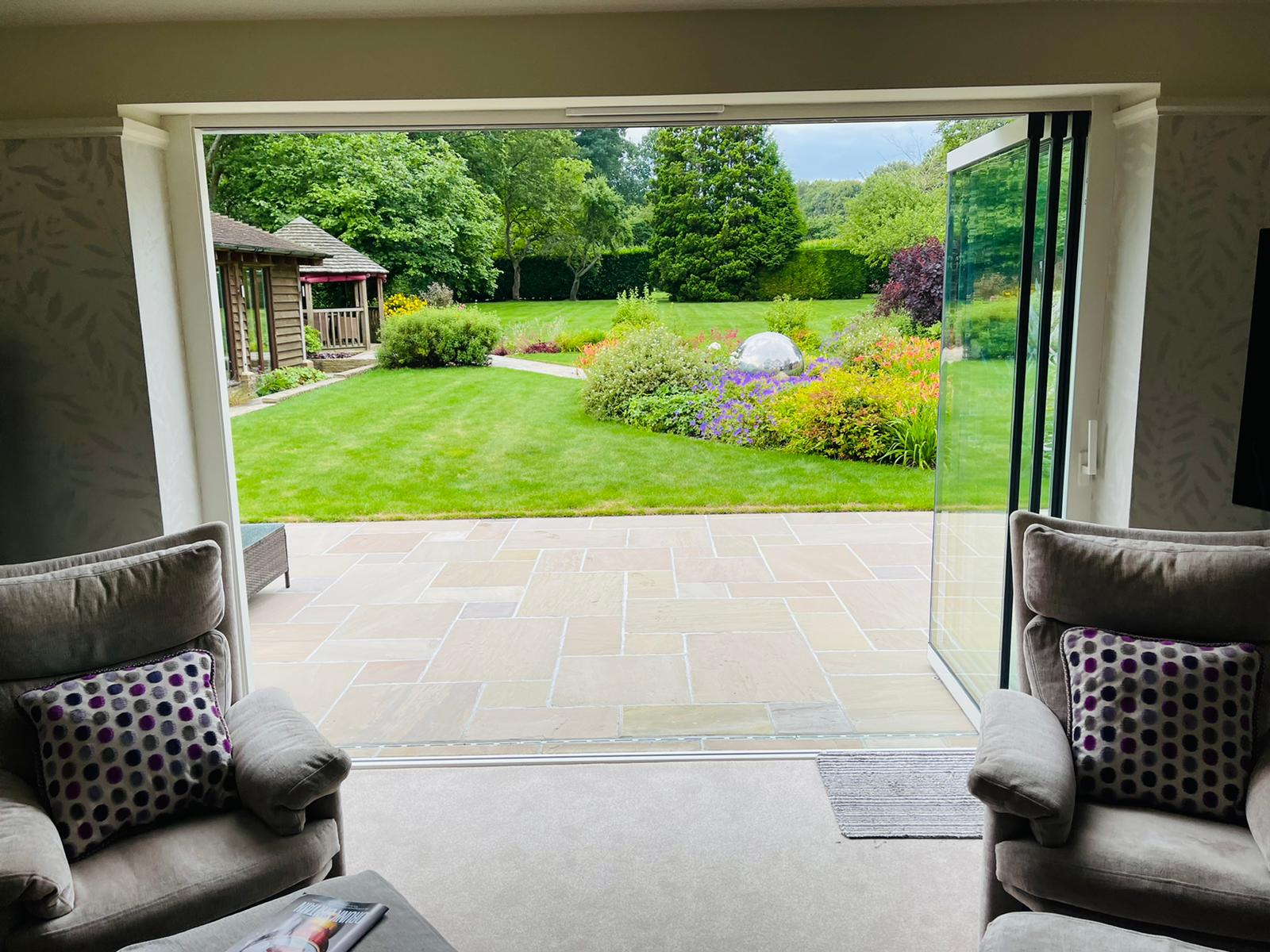 Slide and turn doors in the fully open position with garden views