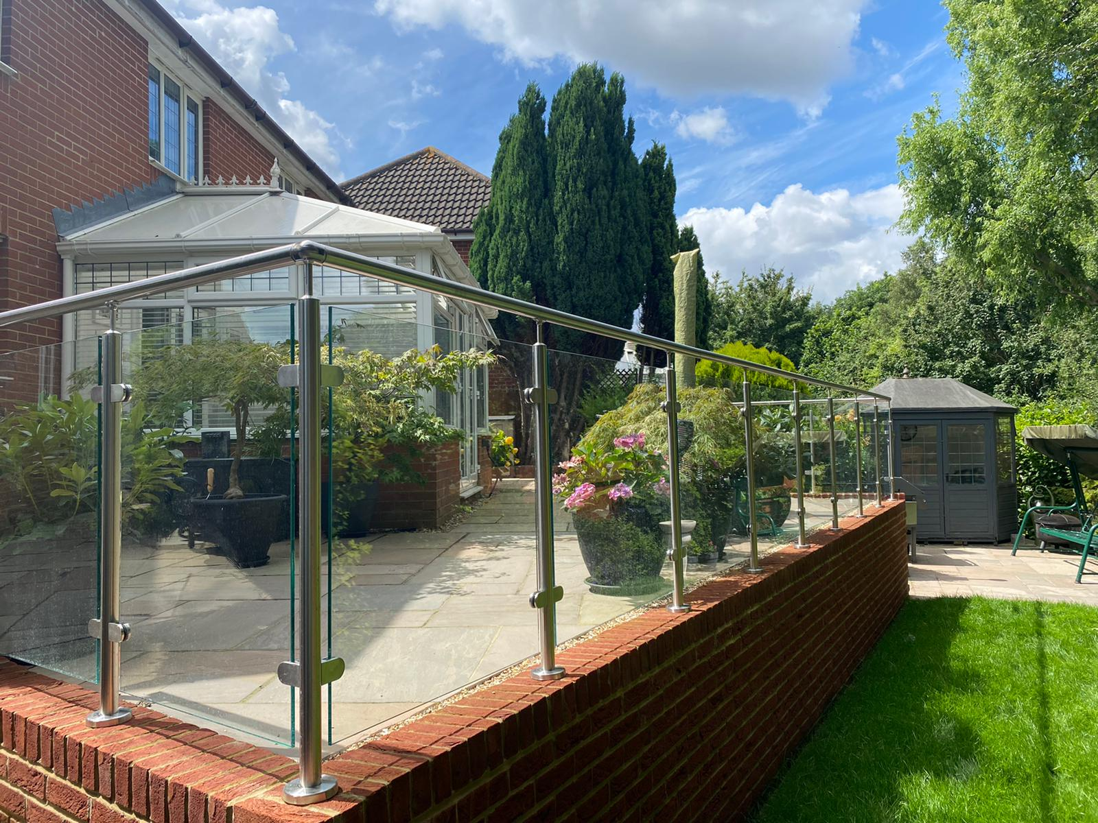 glass balustrades in Kent house on a summer day