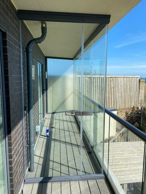 balcony enclosures showing a glass door for access